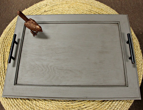 Make a beautiful cabinet door serving tray from items you can find at any ReStore. It's a great way to repurpose a cabinet door! Easy DIY serving tray idea!