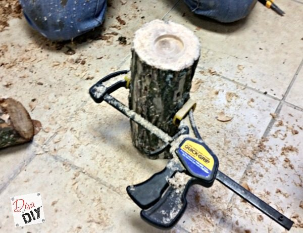 Bring the outdoors in with these inexpensive log candle holders. Perfect rustic decor! You will love using these for your fall decorations and gift giving.