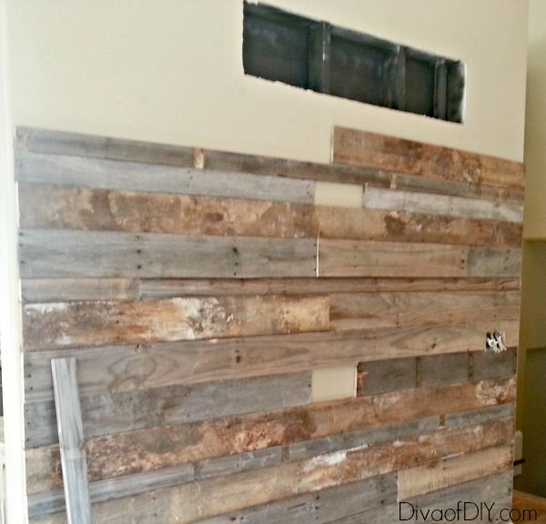 Pallet wood is the perfect substitution for reclaimed barn wood. This DIY Rustic Pallet Wall only costs a few bucks for the nails. Great farmhouse wall art!