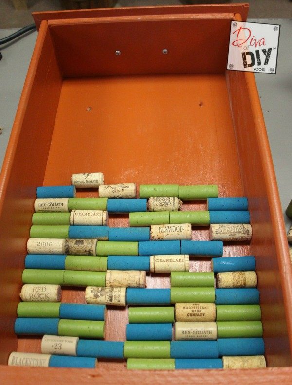 Looking for a unique corkboard idea? Make this DIY cork board with a repurposed drawer and wine corks! The perfect repurposed items project! Cork Crafts!