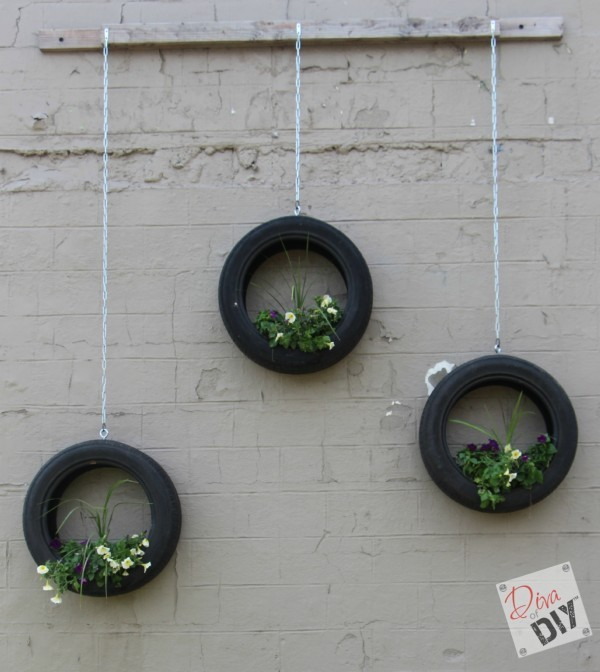 These Tire Planters will make a great conversation piece in your space! An easy bright tire upcycling DIY project that will add fun to your outdoor decor!