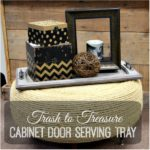 Make a beautiful cabinet door serving tray from items you can find at your local Habitat for Humanity ReStore. It's a great DIY to repurpose a cabinet door!