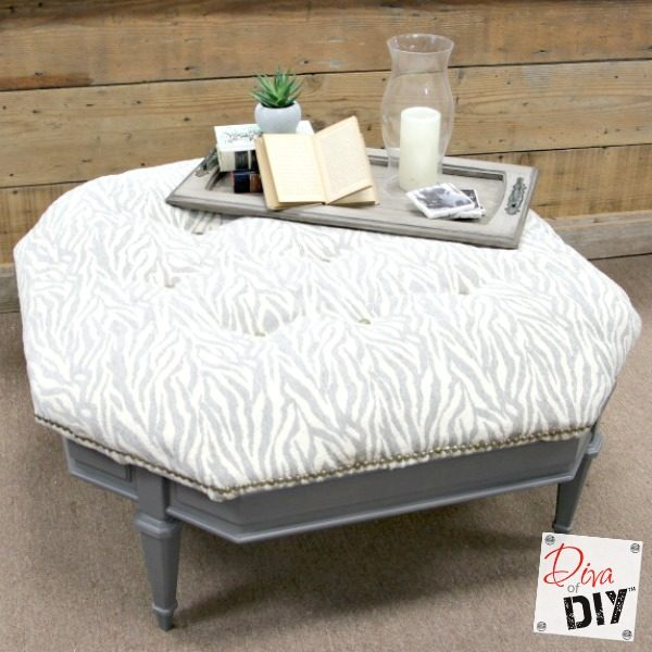 This coffee table ottoman is actually made out of an old table. Tutorial will show you how to make an ottoman and tuft this reupholstered ottoman DIY coffee table.
