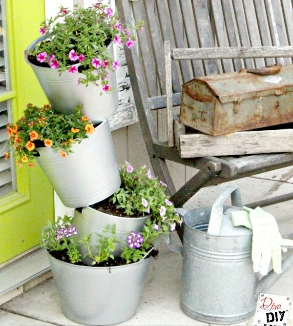 Faux galvanized bucket flower pot made with dollar store supplies!