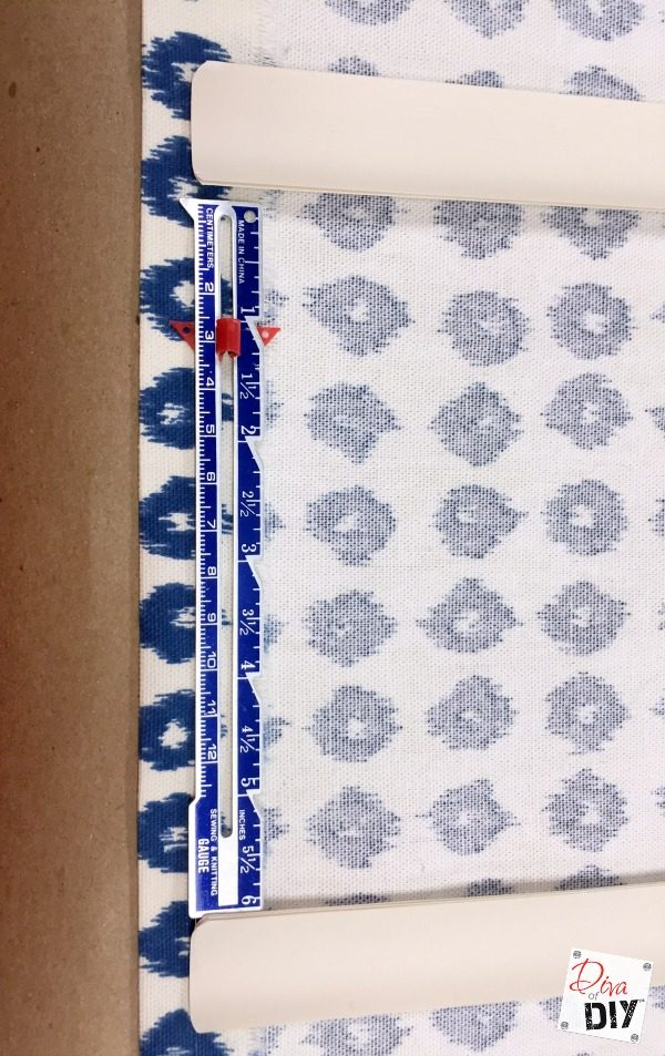 Who says a fabric window treatment has to be expensive! Make these mini blinds into DIY roman shades. It's an easy project no sew window treatment project!