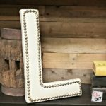 Make a statement with this upholstered monogram letter with nailhead trim. Made with a paper mache letter and left over vinyl fabric. The perfect home decor