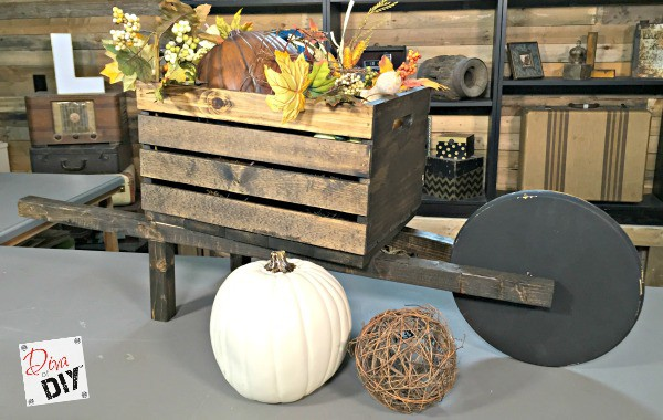 DIY planters that can be changed for the seasons! Make a wheelbarrow planter out of a wooden crate for real flowers or for Holiday Decorating! Think Fall!