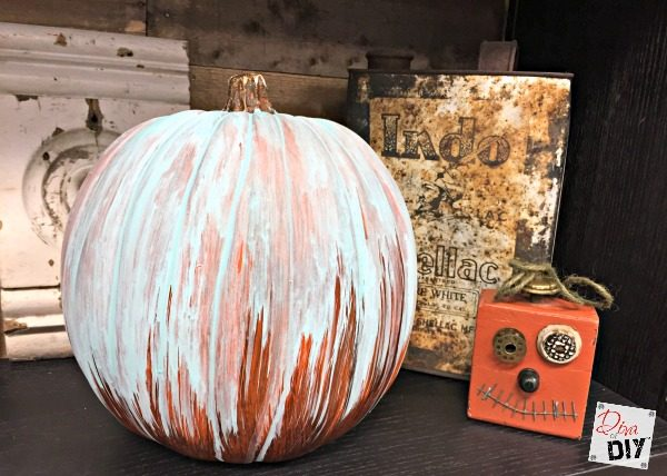 Learn how to create a DIY oxidized patina finish effect with acrylic paint to make your faux pumpkin look amazing! An easy tutorial can be done for pennies!
