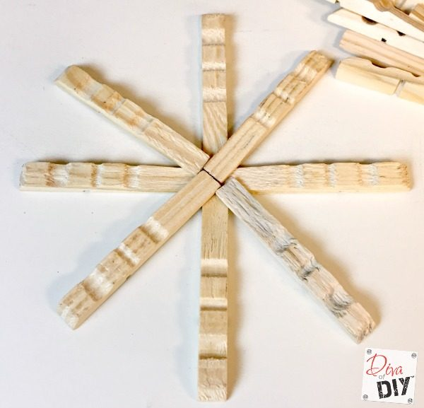 Clothespin crafts are fun for all ages! These clothespin snowflake ornaments are quick and easy to make Christmas ornaments with a rustic or glitter flair!