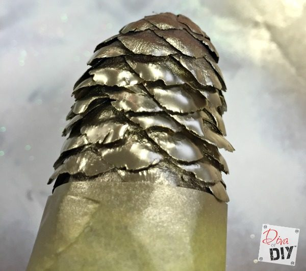 Pinecone crafts can add a rustic touch to your Christmas tree! These DIY pinecone ornaments have a quick and simple paint dipped rustic modern look!