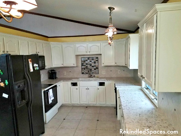 Are your tired oak kitchen cabinets ready for a makeover? Tips and tricks from a professional for painting kitchen cabinets with bonus makeover design tips!