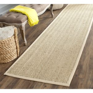 Staircase ideas: This herringbone natural and beige seagrass stair runner adds texture to your boring stairs