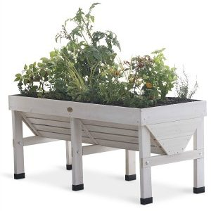 This white washed raised garden bed is both stylish and functional